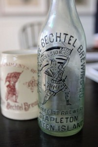 Original Bechtel Beer bottles and mugs line the cabinets in the kitchen. (Staten Island Advance/Jan Somma-Hammel)